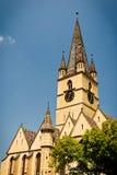 有钟楼的中世纪教会 库存图片