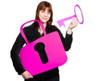 有钥匙和锁的妇女 免版税库存照片