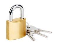 有钥匙的古铜色挂锁 免版税库存照片
