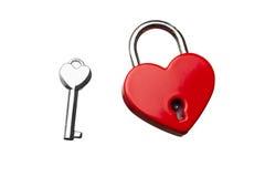 有钥匙的心形的闭合的锁 免版税库存图片