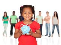 有钱箱的小美国黑人的女孩 免版税图库摄影