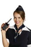 有钶收音机的美丽的微笑的空中小姐 免版税库存图片