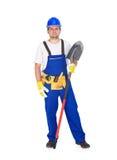 有铁锹的手工建筑工人 库存图片