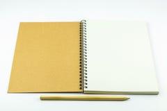 有铅笔的开放笔记本盖子 库存照片