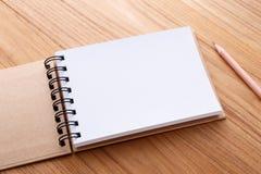 有铅笔的笔记本 库存图片