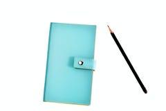 有铅笔的蓝色皮革组织者 免版税库存照片