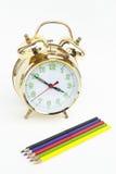 有铅笔的闹钟 免版税图库摄影