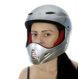 有银色摩托车越野赛盔甲的妇女 免版税库存图片