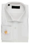 有链扣的被折叠的白色衬衣 免版税库存照片