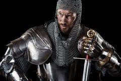有锁子甲装甲和剑的中世纪战士 免版税图库摄影