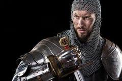 有锁子甲装甲和剑的中世纪战士 免版税库存图片