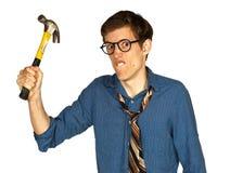 有锤子的恼怒的人 免版税库存照片