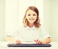 有键盘的学生女孩 免版税库存图片