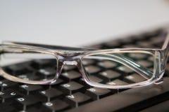 有键盘的镜片 免版税库存照片