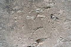 有镇压的水泥灰色墙壁 免版税库存图片