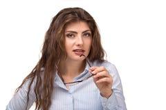 有长卷发微笑的年轻美女,拿着在手中玻璃 老师,accounrtant或者经理职业 免版税图库摄影