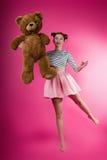 有长毛绒玩具的女孩 免版税库存照片
