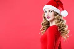 有长的卷发的在圣诞老人帽子的妇女和构成 库存图片