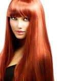 有长的红色头发的妇女 免版税图库摄影