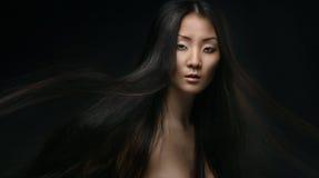 美丽的年轻亚裔妇女 免版税库存照片