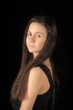有长的头发的青少年的女孩浅黑肤色的男人 免版税图库摄影
