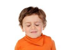 有闭上的眼睛的疲乏的婴孩 免版税库存图片