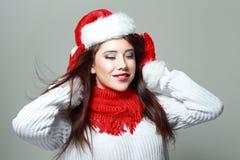 有闭合的眼睛的圣诞老人女孩 库存照片