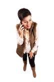 有闭合的眼睛的妇女笑在手机的 免版税库存照片