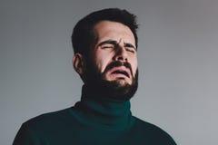 有问题哭泣的年轻人 免版税图库摄影
