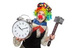 有闹钟的女性小丑 免版税图库摄影