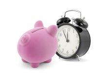 有闹钟的存钱罐 库存图片
