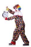 有闹钟的小丑 免版税库存照片