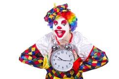 有闹钟的小丑 免版税库存图片