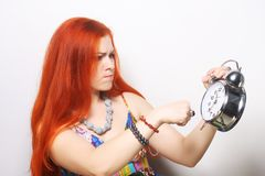 有闹钟的少妇 免版税图库摄影
