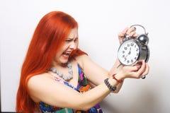 有闹钟的少妇 免版税库存照片