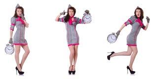 有闹钟的年轻空中小姐在时间管理概念 免版税图库摄影