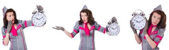 有闹钟的年轻空中小姐在时间管理概念 免版税库存照片