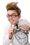 有闹钟的滑稽的医生 库存图片