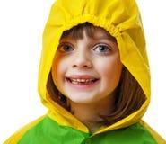 有雨衣的小女孩 免版税库存图片