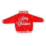 有雪和在上写字圣诞快乐的被编织的毛线衣 免版税库存图片