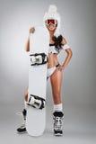 有雪板的性感的女孩 免版税图库摄影