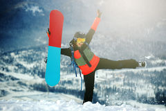 有雪板的美丽的女孩 免版税图库摄影