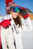 有雪板的美丽的妇女 概念查出的体育运动白色 库存图片