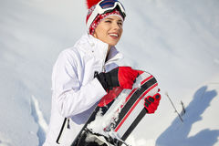 有雪板的美丽的妇女 概念查出的体育运动白色 图库摄影