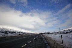 有雪的车行道 图库摄影