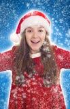 有雪花的愉快的圣诞节女孩 免版税库存照片