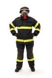 有面具和防护套服的消防队员 免版税库存图片