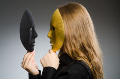 有面具的妇女在滑稽的概念 免版税库存图片