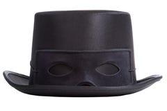 有面具的黑高顶丝质礼帽 免版税库存图片