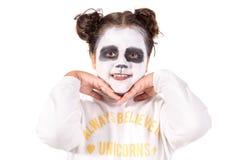 有面孔油漆的女孩 免版税图库摄影